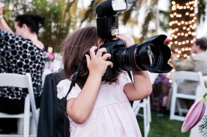 Little girl with a large camera